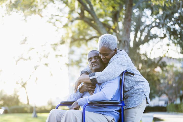 woman hugs stroke survivor