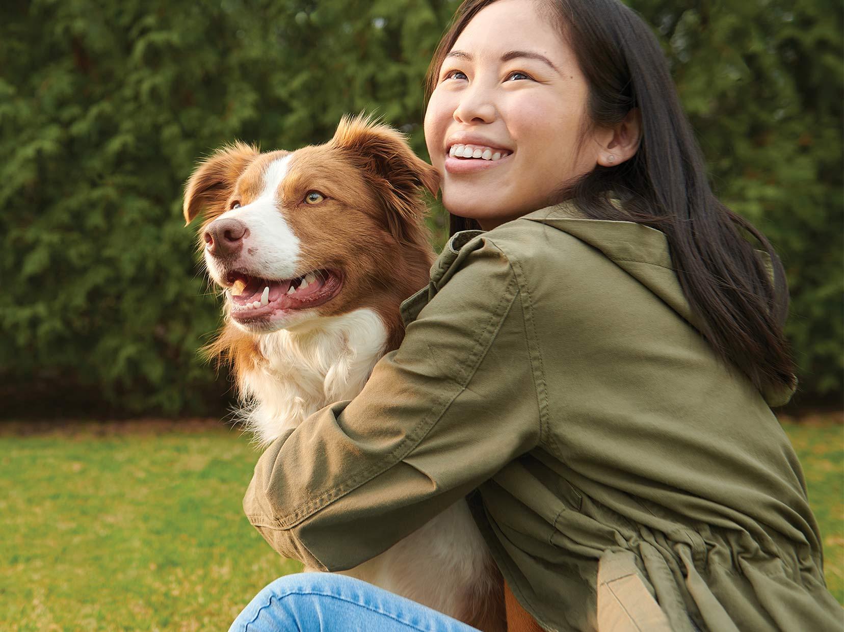 Woman and Dog Embracing