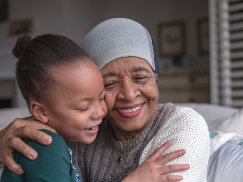 Woman with cancer spending time with her granddaughter