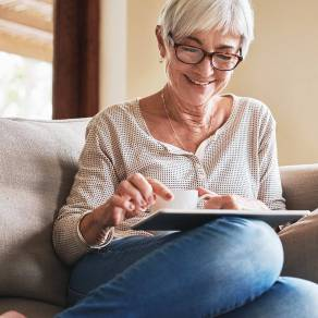 Woman sitting on couch using her ipad