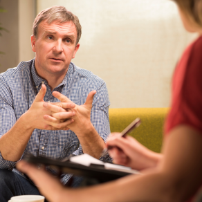 Man talking to counselor