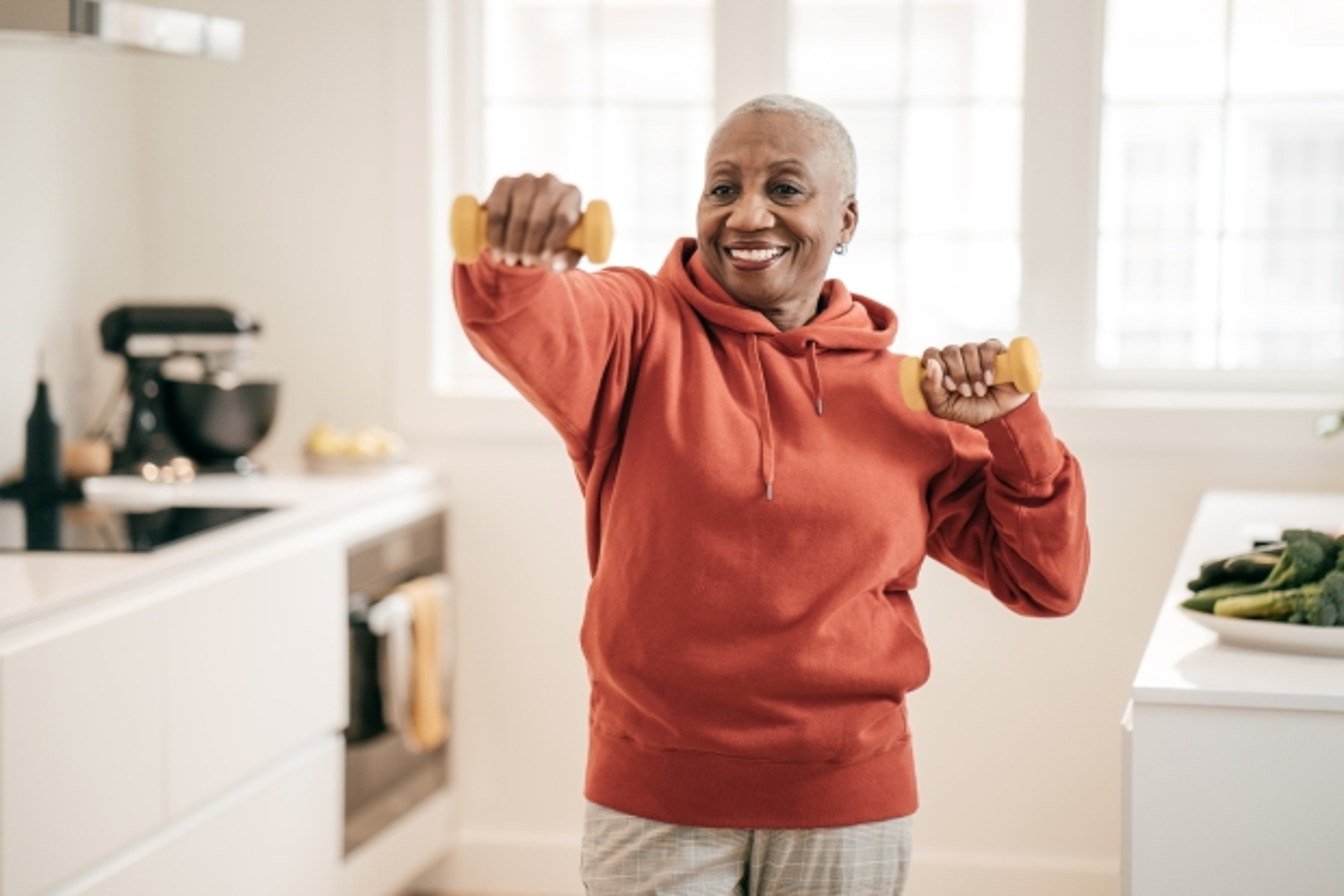 Senior women exercising at home