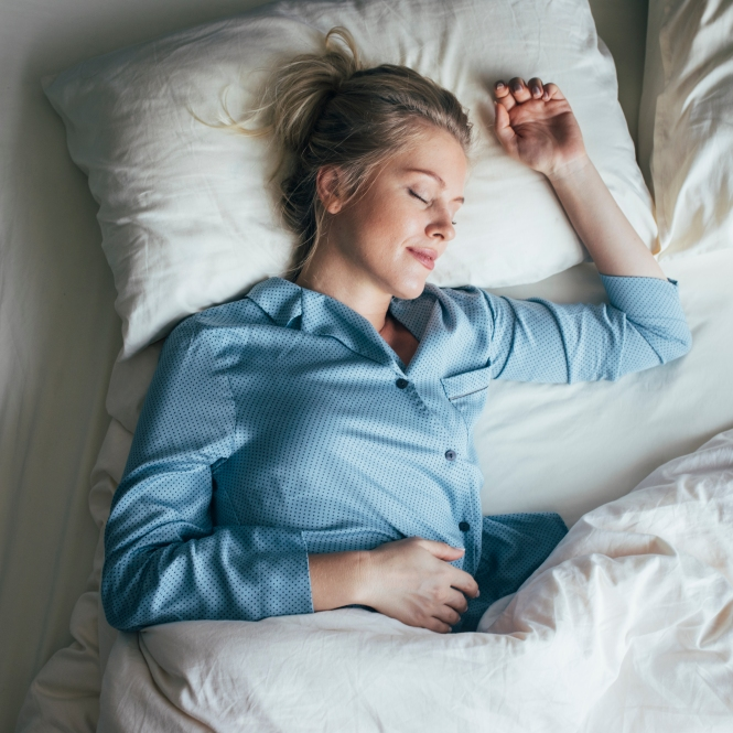 Sound Asleep: Overhead Waist Up Shot of a Pretty Blonde Woman in Blue Pyjamas Sleeping on a King Size Bed