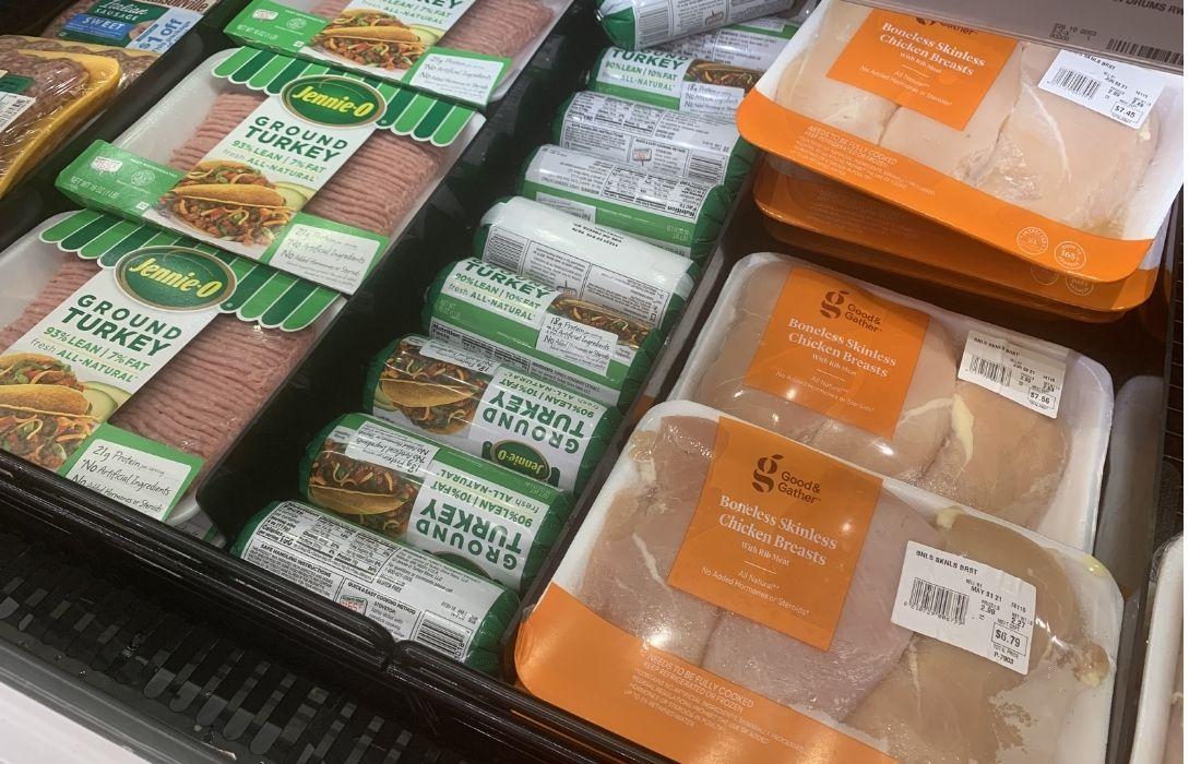 Skinless chicken breast and ground turkey on shelf