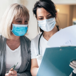 Nurse and patient reviewing chart information – Kettering Health