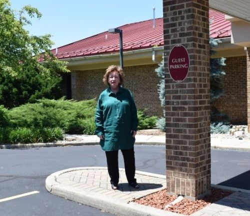 Lisa LePage stands in front of Clearcreek Chapel