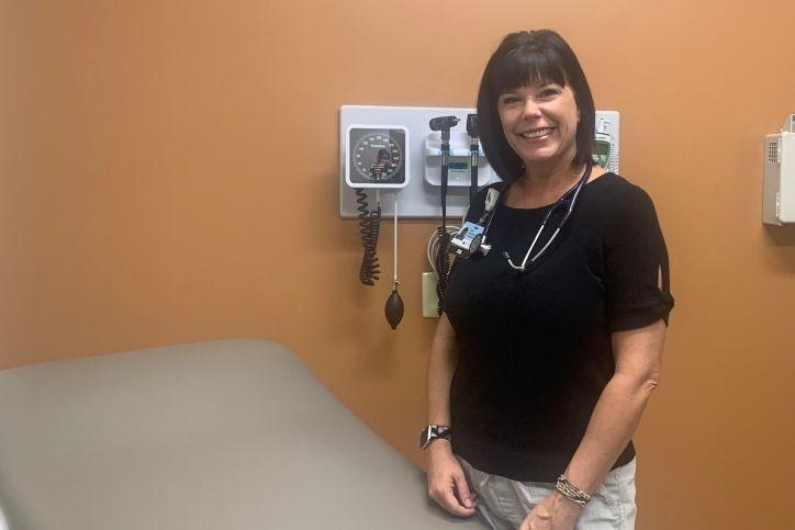 PA Lori Zwickel stands in patient room