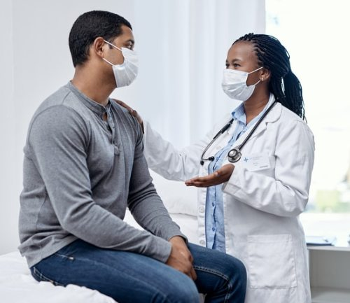 doctor talks with patient during appointment