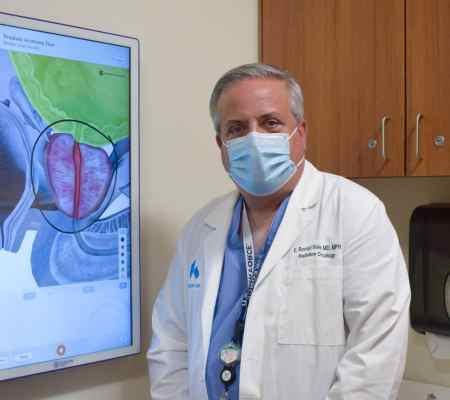 Dr. Hale standing at screen showing prostate
